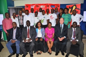 Seated left to right-The panel of judges , Mr. Peter Kahiigi, Dr. John Charles Okiria, Ms. Neema Iyer, Ms. Arigye Maraba Munyangabo, Dowson Kalemba, Mr. Nevin James Bradford and Outbox Team Leader, Richard Zulu (standing extreme right) pose for a picture with the  winning teams