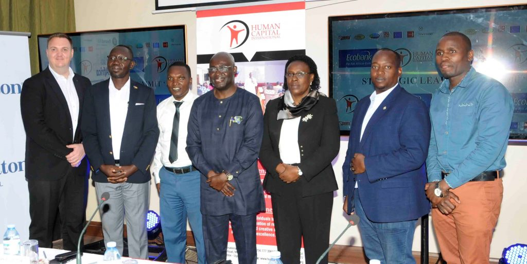 Dei-Tumi (centre) lines up with representatives of major sponsors of the upcoming summit